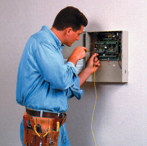 Austin-Alarm-Repair-Tech-Working-On-Panel1-300x297